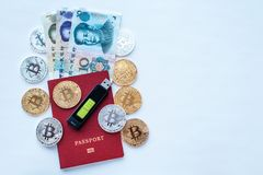 Red passport white background, Chinese yuan CNY with memory card, digital currency bitcoin, gold coins, cold wallet. Flash drive. Encrypt password memory card Royalty Free Stock Photo