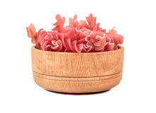 Red pasta fusilli in bowl Royalty Free Stock Images