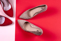 Red and pastel female high-heeled shoes Royalty Free Stock Image