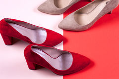 Red and pastel female high-heeled shoes Royalty Free Stock Photos
