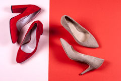 Red and pastel female high-heeled shoes Royalty Free Stock Photography