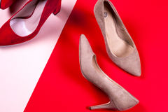 Red and pastel female high-heeled shoes Royalty Free Stock Photo