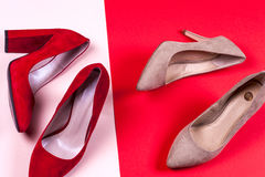Red and pastel female high-heeled shoes Stock Photos