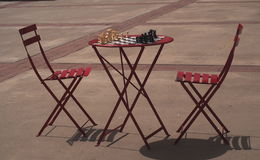 Red Patio Chairs And Table With Chess Game Stock Photos