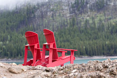 Red pation chairs outdoors on a rainy day Stock Images