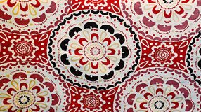 Red Pattern Background. A red, brown and yellow pattern made up of flower or mandala type shapes Royalty Free Stock Photo