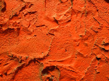 RED. Pattern of plaster on red wall Stock Image