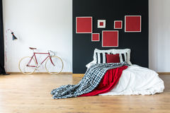 Red coverlet on king-size bed Royalty Free Stock Images