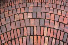 Red paving stones cobbles background. Red paving stones cobbles mosaic texture background stock images