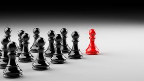 Red pawn of chess. Leadership, success, and teamwork concept, red pawn of chess, standing out from the crowd of black pawns. 3D rendering Royalty Free Stock Photography
