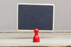 Red pawn with empty blackboard Stock Images