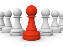Red pawn in front of white pawns Stock Photos