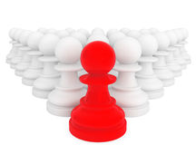 Red pawn in front of white pawns Stock Images