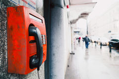 Red payphone on the wall Royalty Free Stock Images