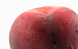 Red peach. Close up of Red peach, isolated on white background Royalty Free Stock Images