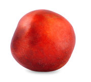 A red peach close-up. Juicy and healthy peach,  on the white background. A whole nutritious fruit full of vitamins. Royalty Free Stock Image