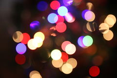 Red and Peach lights blurred. A collection of peach, blue  and Red blurred lights with a dark background Royalty Free Stock Photos