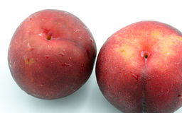 Red peach. On white background Stock Photography