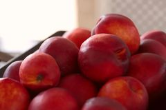 Red peaches. Background. Cropped snapshot royalty free stock photography