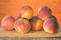 Red peaches. Red and ripe peaches on a rustic wood Stock Photography
