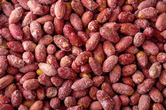 Red peanut salted and roasted seed background Royalty Free Stock Photo