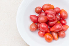 Red Pear tomatoes in a bowl top view close-up Royalty Free Stock Photography