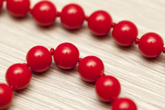 Red pearls background Stock Images