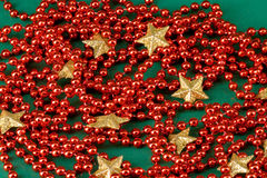 Red pearls and golden stars Royalty Free Stock Images