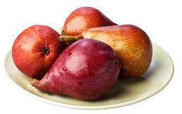 Red Pears on a ceramic plate. Royalty Free Stock Images