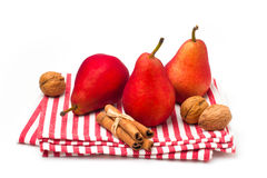 Red pears on striped tablecloth Royalty Free Stock Photo