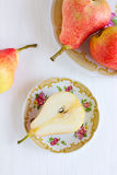 Red pears on the white table Stock Photo