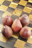 Red Pears on a Wooden Chess Board Stock Photo