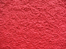 Red pebble dash wall Stock Photography