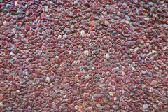 Red pebble wall Stock Image