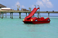 Red Pedal Sliding Boat in Maldives. Red Pedal Sliding Boat on turquoise color water at Maldives Stock Photography