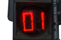 Red pedestrian traffic light. Pedestrian traffic light of red color warns that it is one second left for the green light. Isolated against white background Royalty Free Stock Image