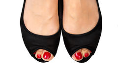 Red pedicure&black shoes-5. Female foot with pedicure in black shoes on a white background Royalty Free Stock Photography