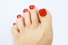 Red pedicure. Female foot with red pedicure, close up Royalty Free Stock Photos