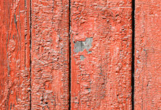 Red peeling paint on wood Royalty Free Stock Image