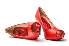 Red Peep Toes. Red high heel shoes in front of white clean background with shadows Royalty Free Stock Photos