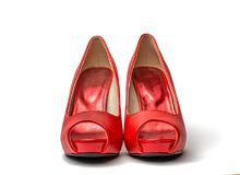 Red Peep Toes. Red high heel shoes in front of white clean background with shadows Stock Image