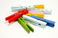 The red peg on top colorful wooden pegs Stock Photo