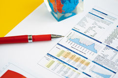Red pen on a background of finance diagram. Red pen on a background of diagrams.  Close up Royalty Free Stock Photos