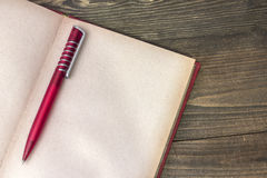 Red pen with book Stock Photo