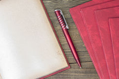 Red pen with book Royalty Free Stock Photos