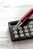 Red pen and calculator Stock Images