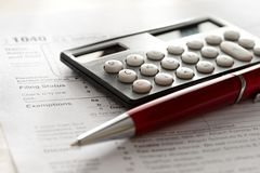 Red pen and calculator Royalty Free Stock Photography