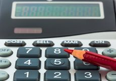 Red pen and calculator Stock Photo