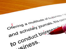 Red pen correcting. Proofread english text Stock Image