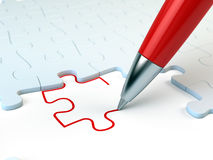 Red pen drawing a puzzle piece. Solution concept Royalty Free Stock Image